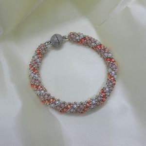 Jewelry - Peach, white and pink hand beaded bracelet